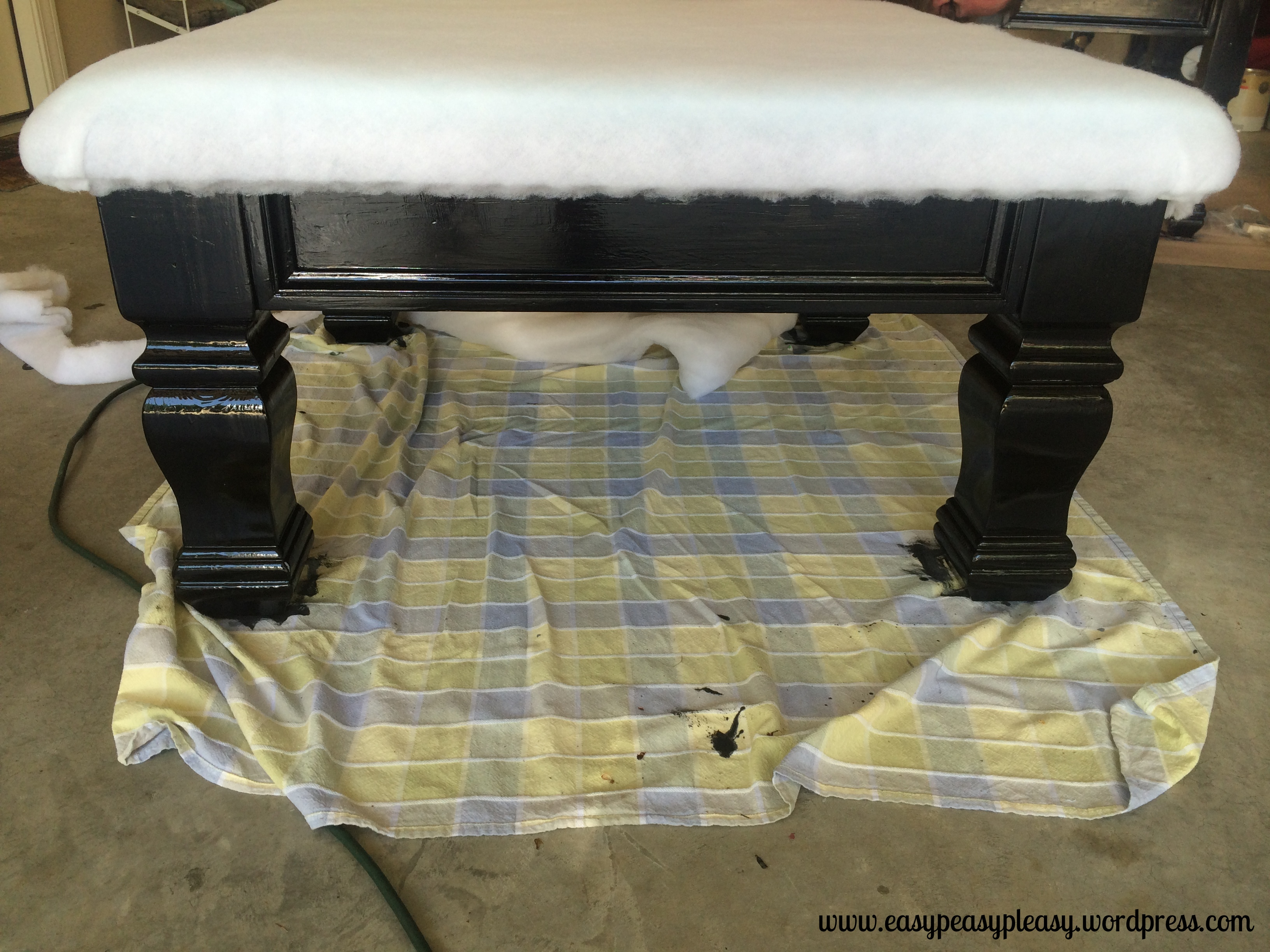 Adding loft batting to a #DIY table turned ottoman.
